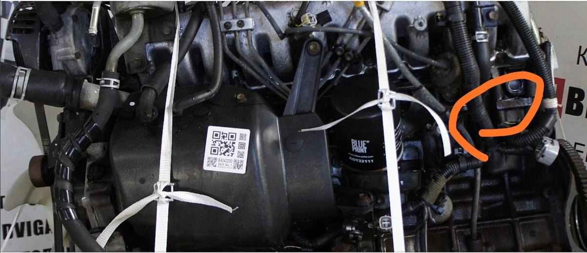 Расположение номера двигателя Toyota 1AZ-FE 2.0 л.
